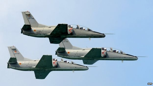 Sri Lankan Air Force aircraft fly in formation during a Victory Day parade in the southern town of Matara, 18 May 2014
