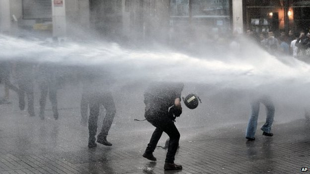 Riot police use water cannons and teargas to disperse people who were protesting the Soma mine accident that killed 301 miners, in Istanbul, Turkey, 17 May 2014