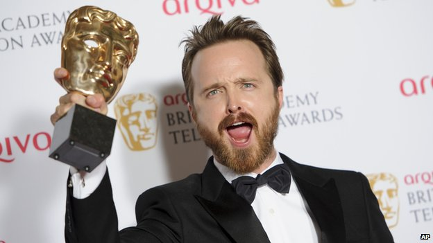 Breaking Bad's Aaron Paul with his  Bafta international award