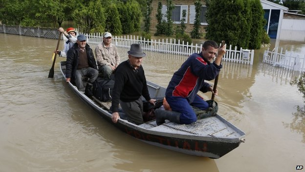 Bosnian people are rescued from their flooded houses by boat in the village of Vidovice near Orasje 200km (124 miles) north of Sarajevo