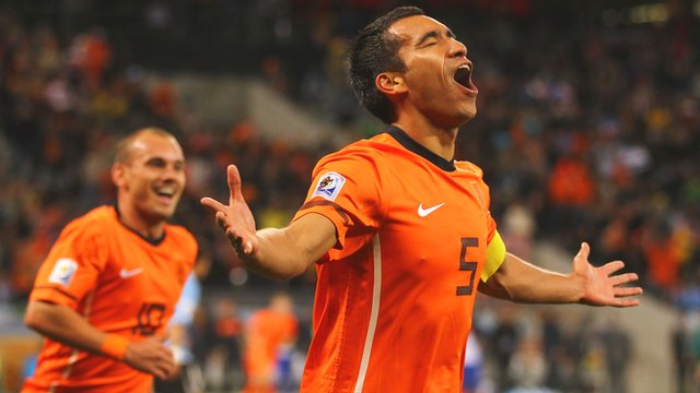 Netherlands captain Giovanni van Bronckhorst scores at the 2010 World Cup