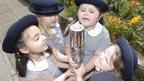 Schoolgirls holding the Queen's Baton