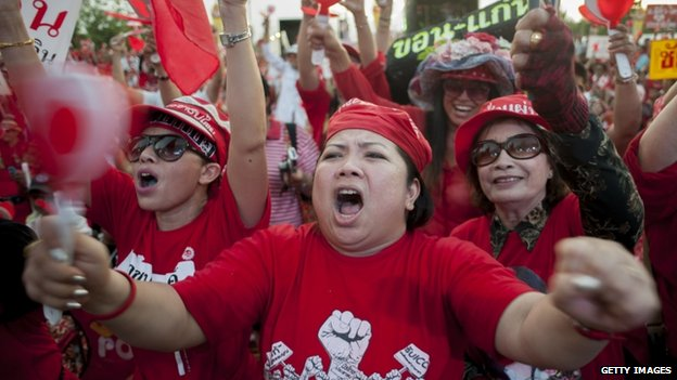 Pro-government red shirt supporters react to a speech during a large rally on the outskirts of the Thai capital on 10 May 2014 in Bangkok, Thailand