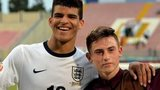 England's Dominic Solanke (l) and Patrick Roberts