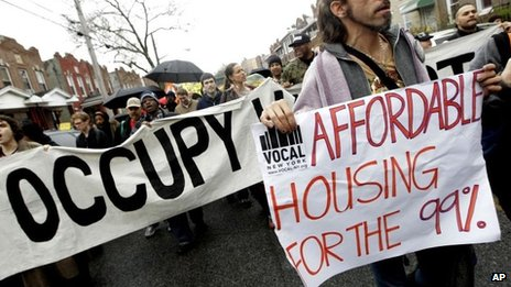 Occupy Wall Street activists march during a tour of foreclosed homes in the East New York neighbourhood of the Brooklyn borough of New York 6 December 2011