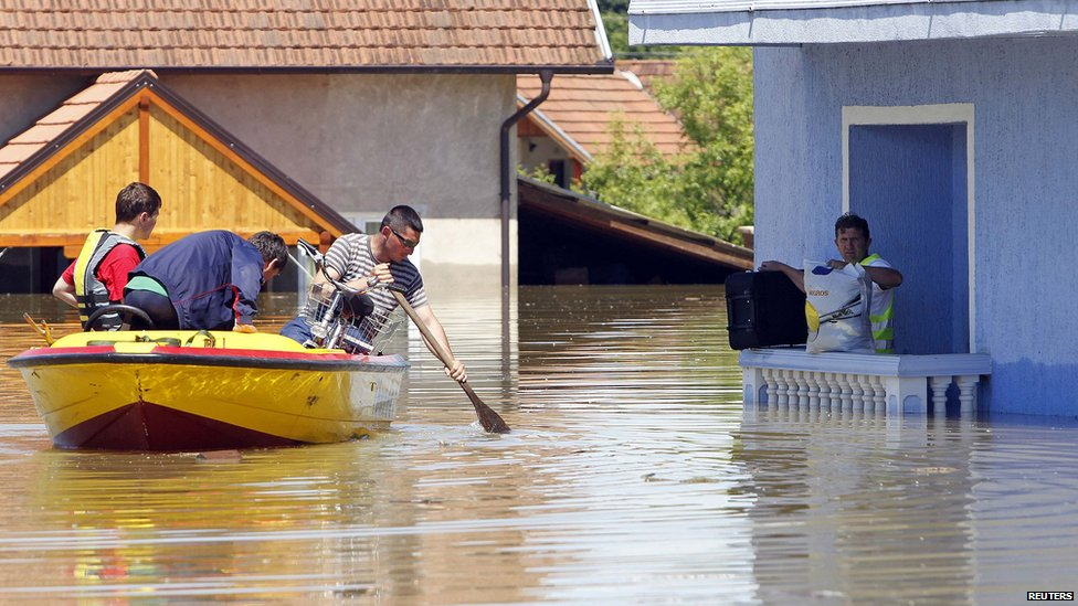 Man waits to be rescued from his house in Vojskova, Bosnia. 19 May