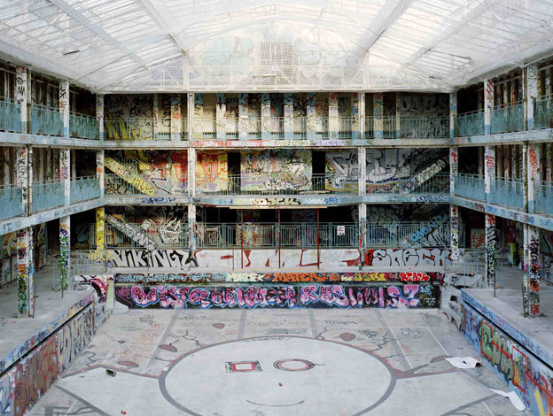 The indoor pool covered in graffiti