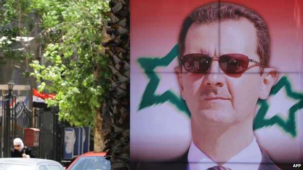 An election campaign poster bearing a portrait of President Bashar al-Assad (May 2014)