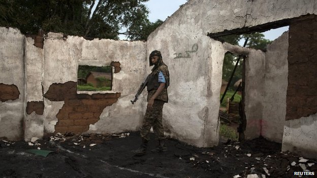 A Seleka soldier stands in the ruins of a mosque near Bambari on 10 May 2014