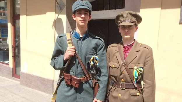 Tourism workers dressed in the uniforms of the Ukrainian Insurgent Army in Lviv
