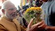 Narendra Modi receives a bouquet from BJP MPs in Delhi on May 20, 2014
