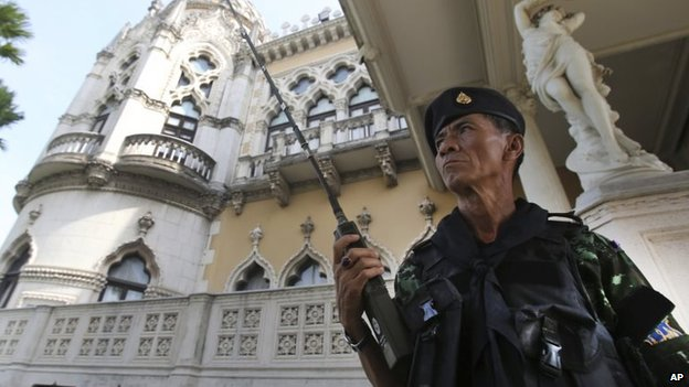 A Thai soldier outside Government House, Tuesday, May 20, 2014