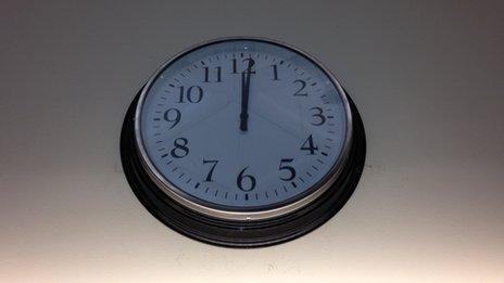 library clock at midnight