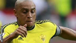Roberto Carlos got a Bugatti from Anzhi's president, claims Toure's agent