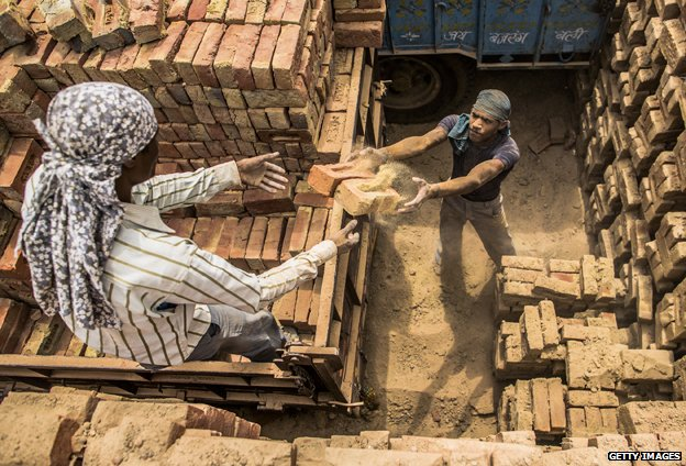 Men making bricks, India