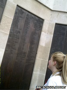 Pupil looking at memorial board