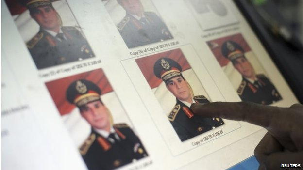 Finger pointing to image of Abdul Fattah al-Sisi on a screen