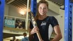 Northern Ireland's pole vault record-holder Zoe Brown takes a break from training to hold the baton.