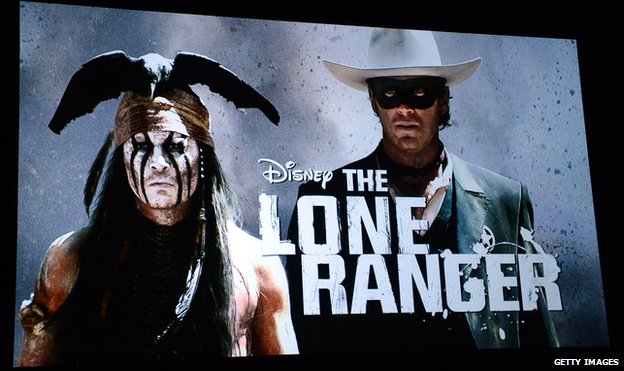 An image on screen during a presentation shows actor Johnny Depp (L) as the character Tonto in the film The Lone Ranger