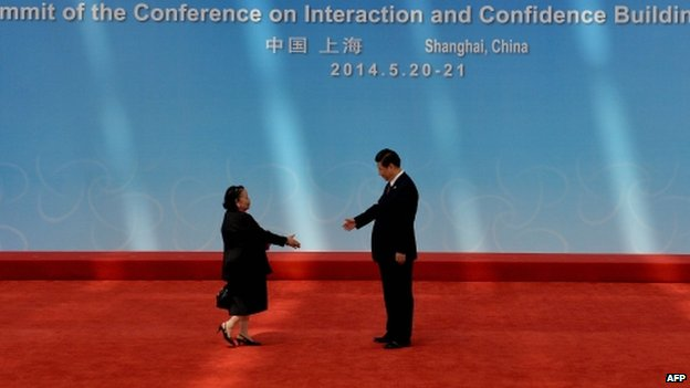 Philippines Ambassador to China Erlinda Basilio (L) is greeted by Chinese President Xi Jinping before the opening ceremony at the Expo Centre at the fourth Conference on Interaction and Confidence Building Measures in Asia (CICA) summit in Shanghai on May 21, 2014