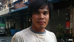 Filippino migrant worker 'Tata' poses for a picture