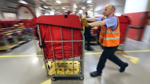 Man pushing sorted parcels