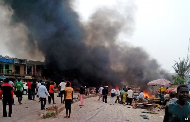 Smoke rises after a bomb blast at a bus terminal in Jos, Nigeria, on 20 May 2014