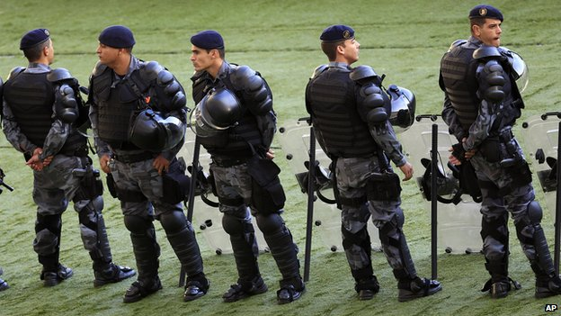 Brazilian soldiers standing outside the Maracana stadium in Rio