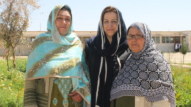 Saeeda (centre), flanked by two women in Helmand - all wearing headscarves instead of burqas