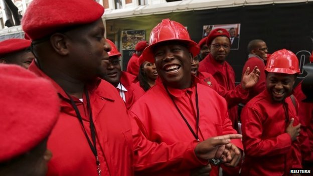 Economic Freedom Party (EFF) leader Julius Malema (C) arrives to be sworn in as a member of parliament at the South African Parliament in Cape Town on 21 May  2014