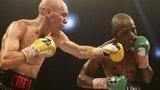 Stuart Hall punches Vusi Malinga