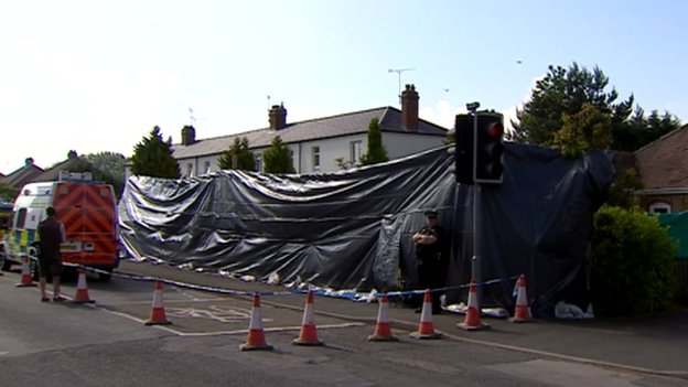 Home covered by black tarpaulin