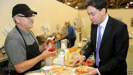 Ed Miliband buying a bacon sandwhich from a cafe in New Covent Garden market in London