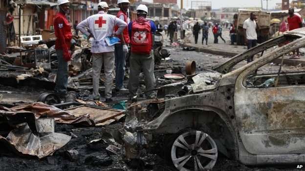 Red Cross personnel search for remains at the site of one of Tuesday's car bomb in Jos, May 21