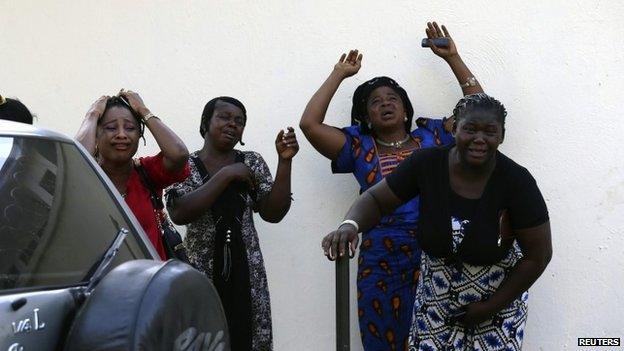 Bystanders react as victims of a bomb blast arrive at the Asokoro General Hospital in Abuja April 14