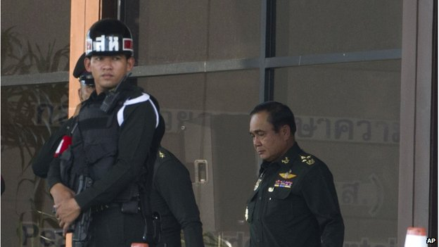Thai Army Chief General Prayuth Chan-Ocha exits the army club Wednesday, 21 May, in Bangkok, Thailand