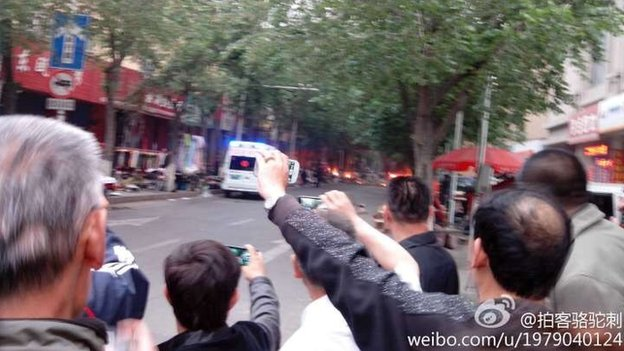 Onlookers in Urumqi after blast in the market (22 May)