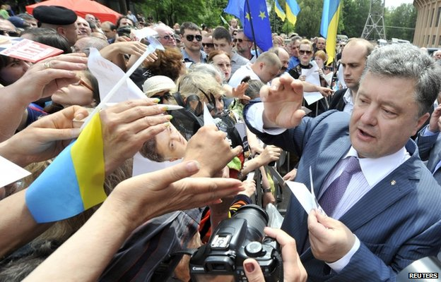 Ukrainian businessman, politician and presidential candidate Petro Poroshenko (R) meets his supporters during his election rally in the city of Krivyi Rih May 17, 2014.