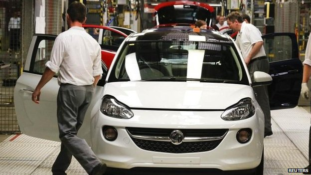 Employees work at the production line on an Opel Adam car in Germany