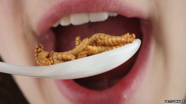 Woman about to eat a spoonful of worms