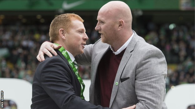 John Hartson (right) presents Neil Lennon with this season's championship medal