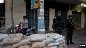 Thai soldiers stand guard outside the main camp-site of anti-government protesters in Bangkok