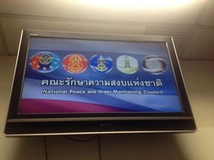 A television screen displaying the Thai army's message
