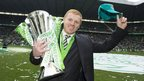 Neil Lennon poses with the 2013/14 Scottish Premiership trophy