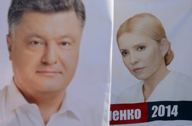 Placards depicting Petro Poroshenko (left) and Yulia Tymoshenko in Lviv, Ukraine, 21 May