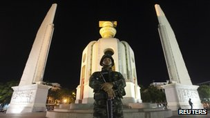 A Thai soldier stands guard at the Democracy Monument after a coup in Bangkok May 22