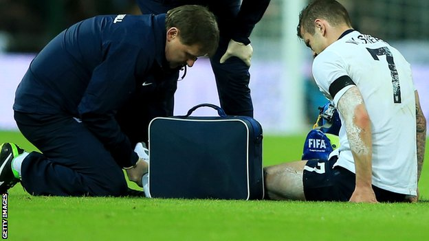 Jack Wilshere is given treatment during the International Friendly match between England and Denmark.