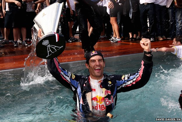 Mark Webber celebrates in a pool