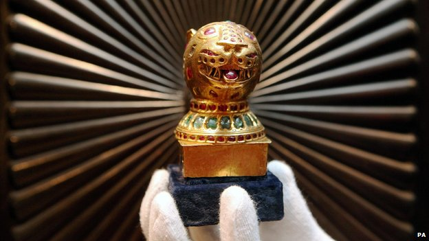 A gem-encrusted gold finial from the octagonal golden throne of Tipu Sultan, the Tiger of Mysore, at Bonhams in London where it will be going under the hammer on 7 October as part of the Indian and Islamic Art Sale. The first of these sold in April 2009 for 389,600. 04/10/2010