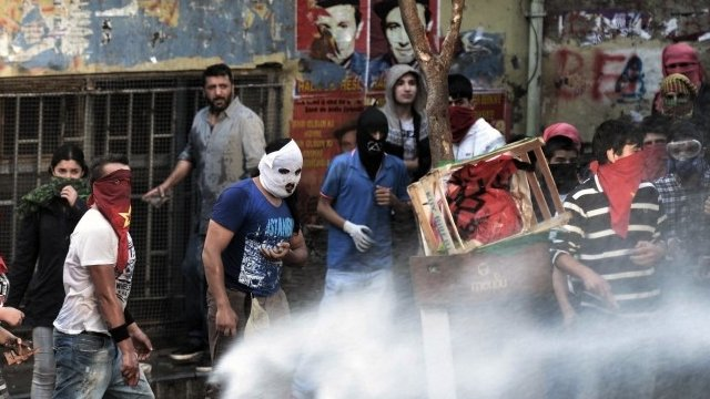 Police use water cannons and teargas to disperse people who are protesting at the Soma mine disaster